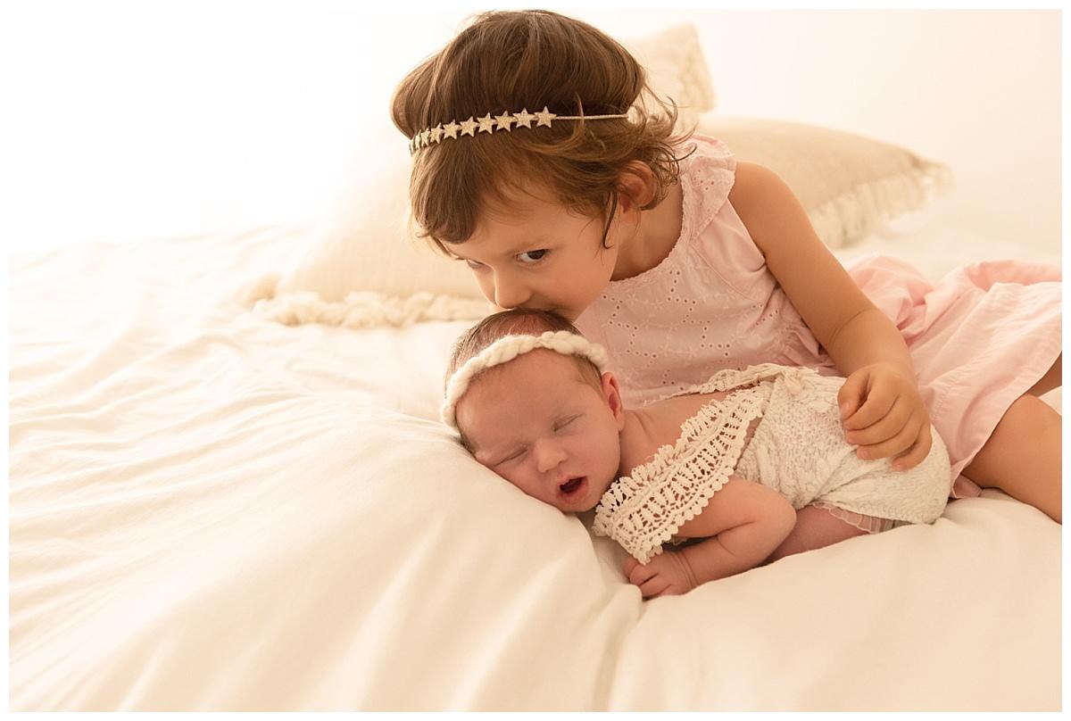 photo bébé avec sœur